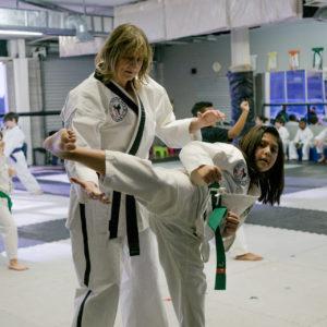 Karate kick Impact Martial Arts training classes
