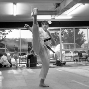 High kick martial arts taekwondo training classes Impact Martial Arts Pelham