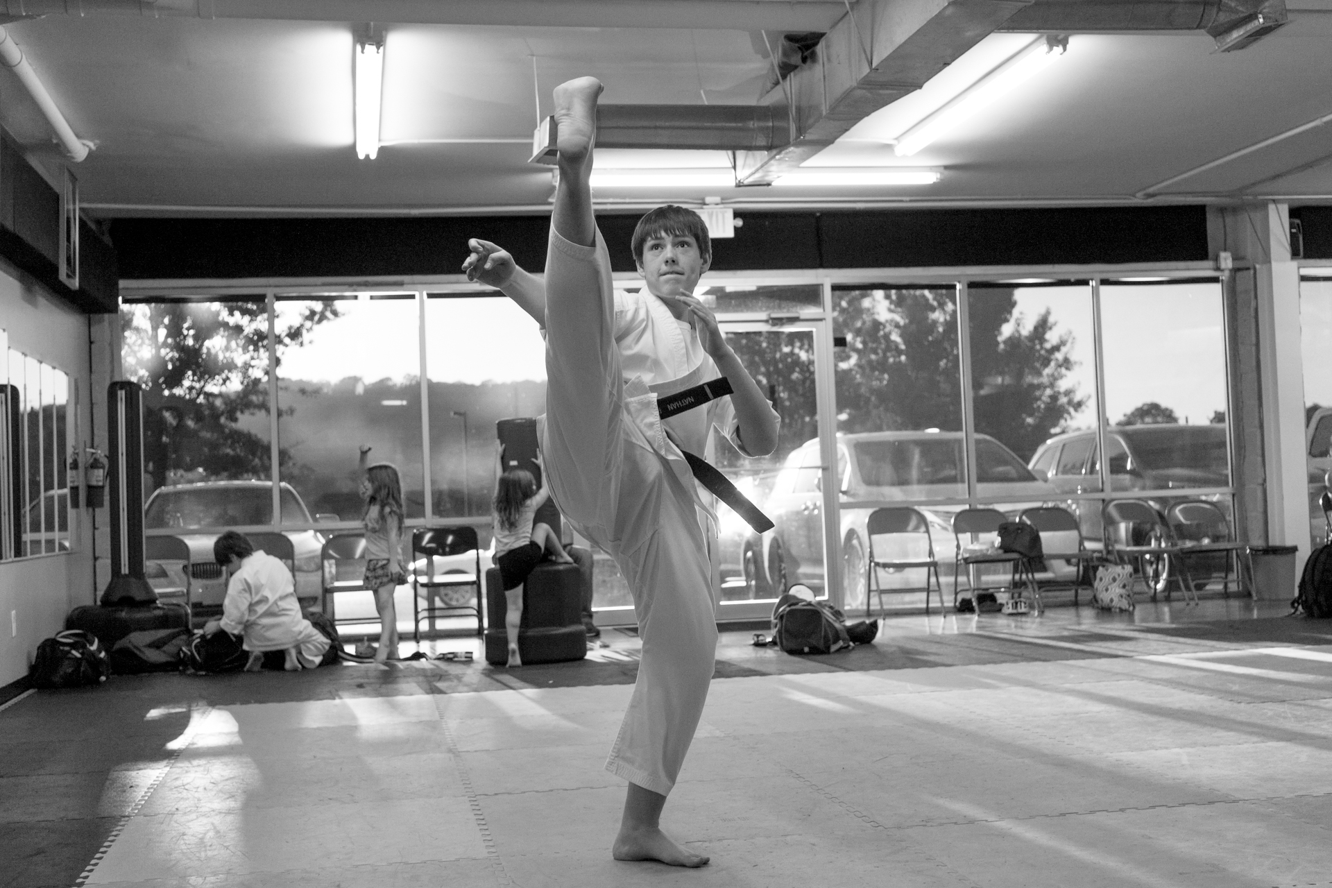 High kick martial arts taekwondo training classes Impact Martial Arts Pelham